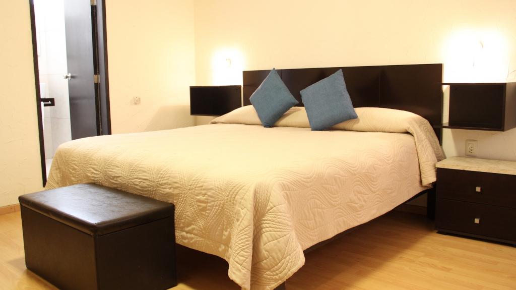 Suite principal hotel la parroquia for Cama de 54 pulgadas